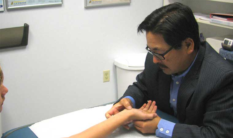 dr_choi_evaluating_patient_wrist
